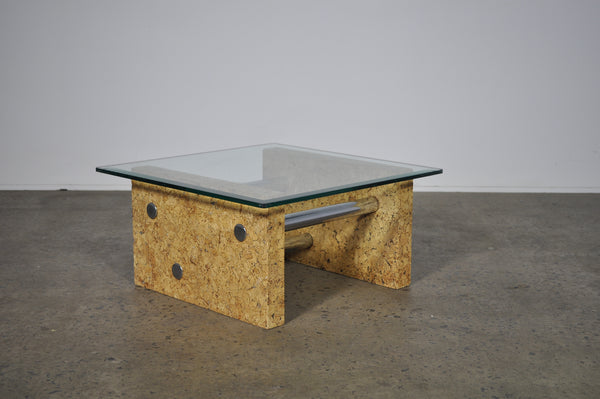 Brutalist glass coffee table with cork base.