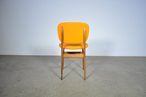 Elite dining chairs . Set of six in Orange felt.