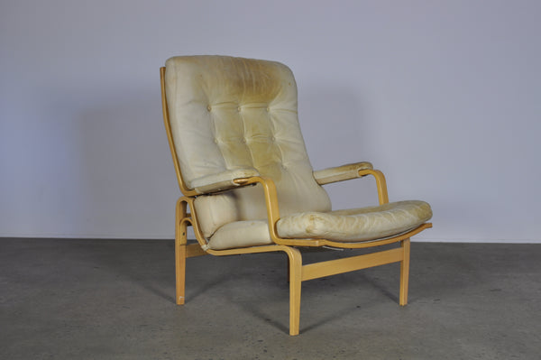 Bruno Mathsson in white leather Ingrid armchair.