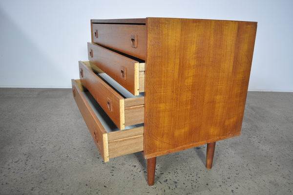 Teak storage unit with drawers.