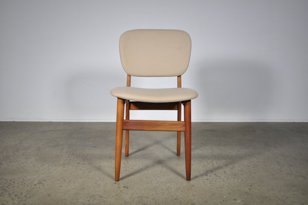 Elite dining chairs with Maharam wool.