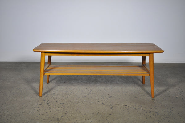 Coffee table of beech and teak.