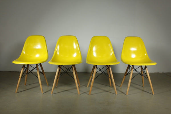 Eames Yellow Fibreglass Dining chairs with Timber legs - Case 22