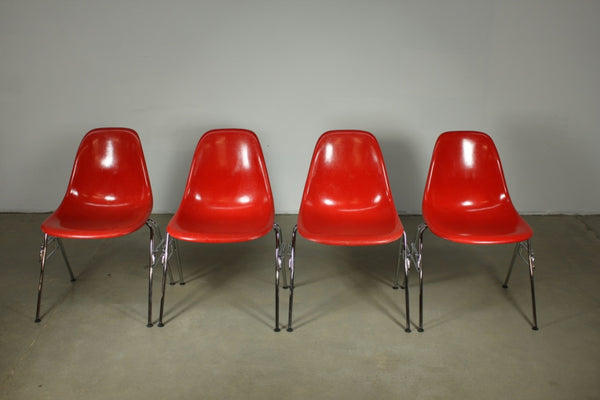 Eames Red Fibreglass Dining chairs with metal stackable legs - Case 22