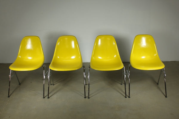 Eames Fibreglass dining chair in yellow with stacking legs - Case 22