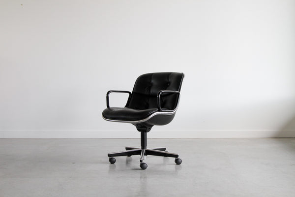 Knoll Pollock chair with armrests.