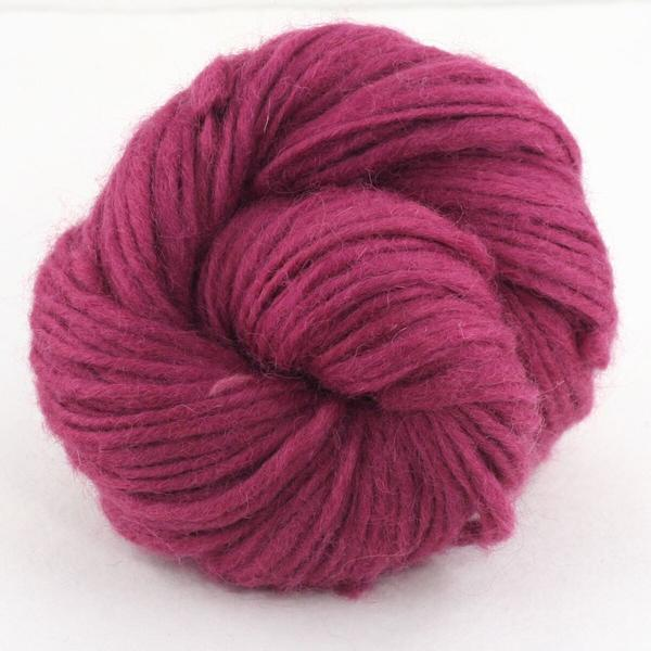 Pink ball of wool yarn on a white background