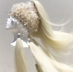 One of Collin's most difficult pieces. A snow white wig with large white gems.