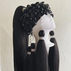 One of Collin's most difficult pieces. This is a black wig with large black gems.
