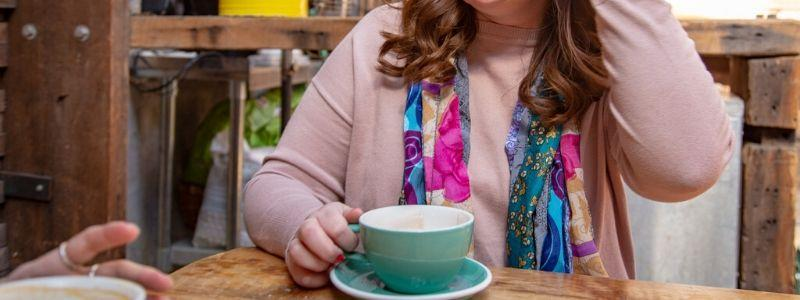 Women wearing mystery sari silk medly scarf drinking coffee at a coffee shop