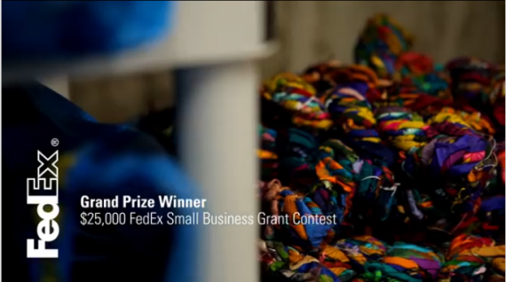"yarn in a background, with fedex logo and text that says ""grand prize winner. $25,000 FedEx small business grant contest."
