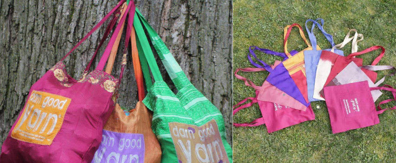 The Sari Silk Tote Bags hanging on a tree