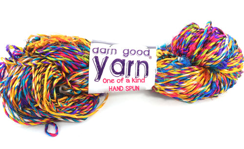 multicolor yarn skein with white label that says darn good yarn