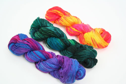 multicolored yarn skeins over a white background