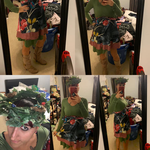 A collage of pictures from a model dressed as Mother Nature. She is taking pictures in front of her mirror, wearing a dark green skirt with a multicolored flower pattern, a long sleeved olive shirt, and a wreath of leaves around her head like a crown.