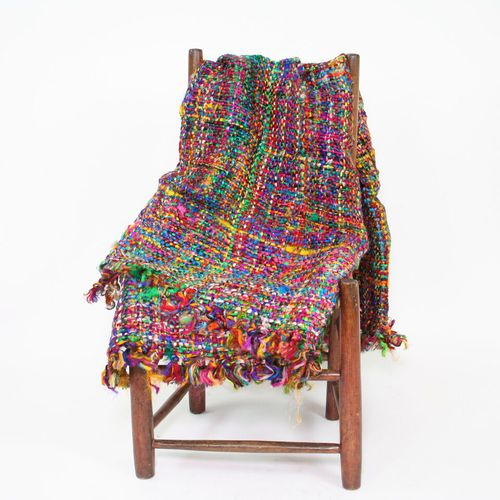 yarn blanket over chair