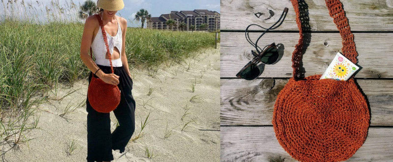 Beach Day Bag worn by a woman on the beach