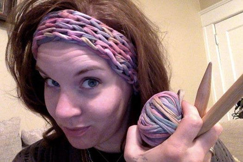 woman wearing yarn bandana and skein of yarn