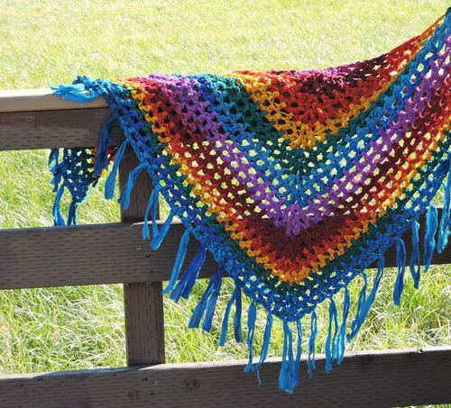 yarn shawl over a fence