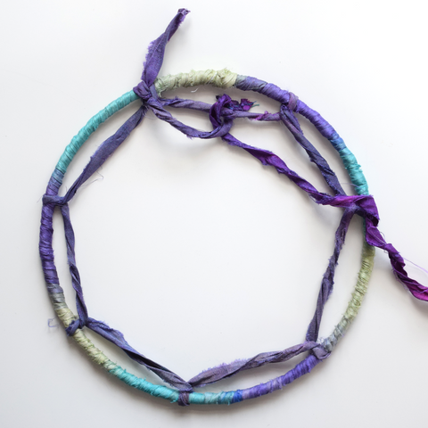 Adding loops to inside of dreamcatcher ring with purple recycled sari silk ribbon yarn