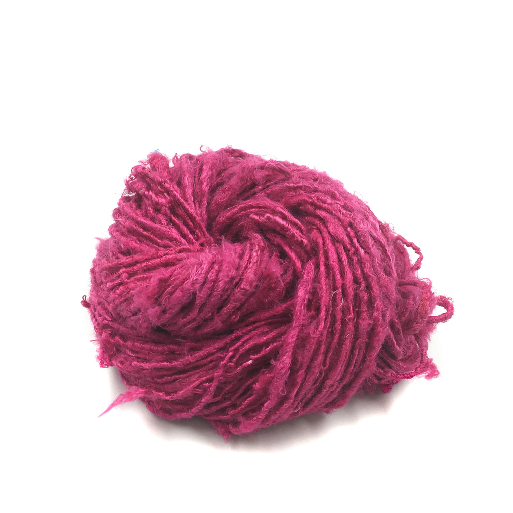 Banana fiber yarn ball in Rich Magenta on a white background