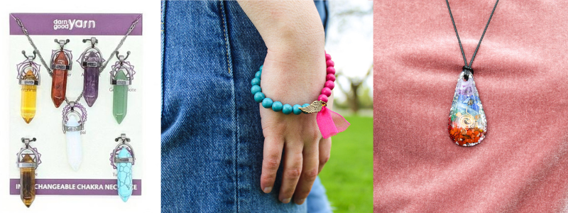 Three examples of our handmade jewelry.  In order from left to right: our Interchangeable Chakra Necklace, Jeweled Angel Wing Bracelet, and our Chakra Alignment Necklace.
