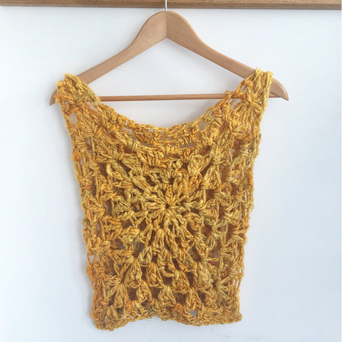 Yellow sunny days crochet tank top on a white background