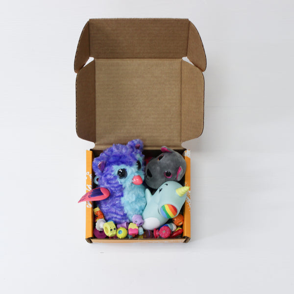 Darn Good Yarn box in yellow holding stuffed toys