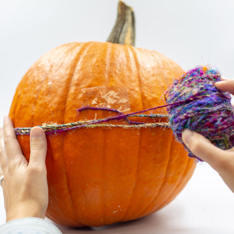 Step 2: tape the end of your yarn to the pumpkin
