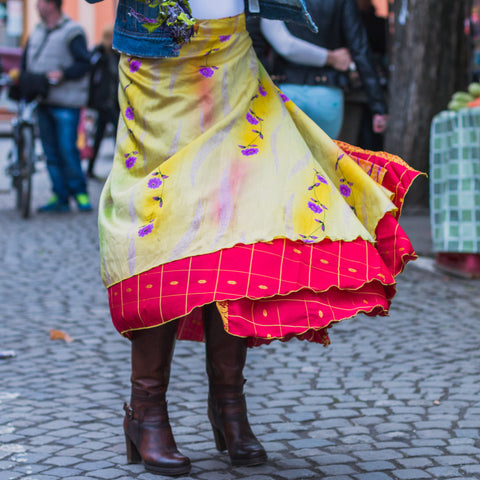 Close up of woman wearing a sari wrap skirt and winter boots