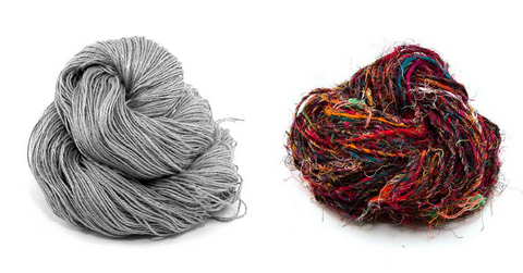 Two skeins of gray and multicolored yarns sitting on a white background