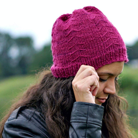 Close up of woman wearing a pink Autumn Arrow Winter Hat