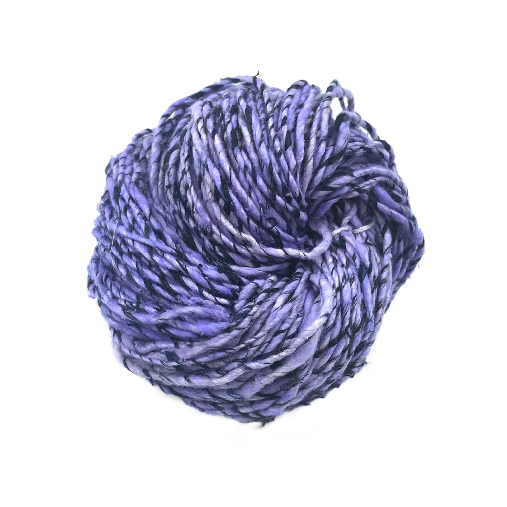 Ball of Black and Hue Worsted Weight Silk Yarn in Mystic Shadows colorway on a white background