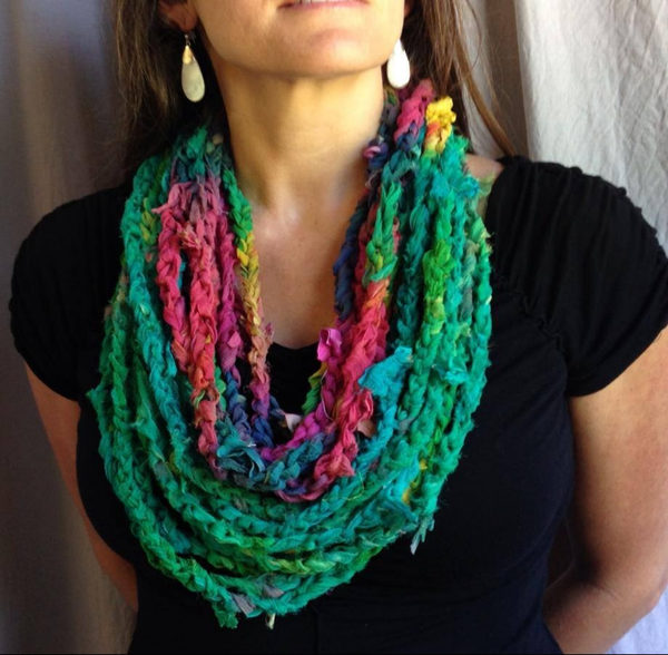 woman wearing a yarn scarf