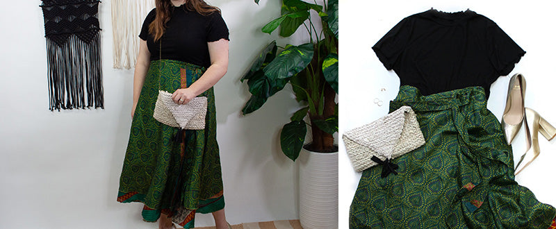 women with shiny green sari wrap skirt with black lettuce edge shirt and recycled sari bag