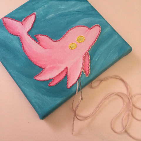 Maryssa incorporates embroidery into paintings.