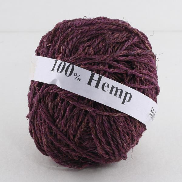 Purple ball of hemp yarn with a white label that reads '100% Hemp' sitting on a white background