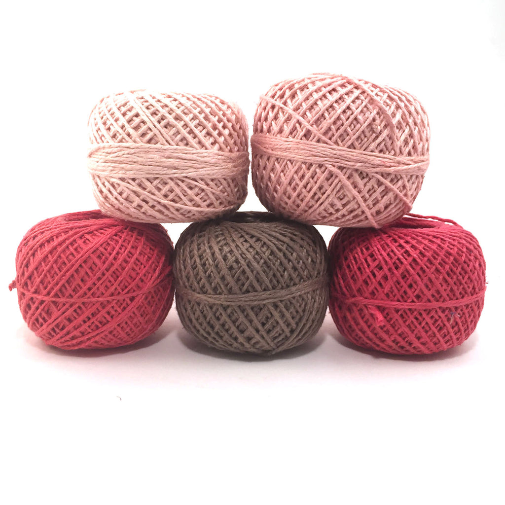 Stack of 5 Naturally Herbal Dyed Recycled Silk Yarn cakes on a white background