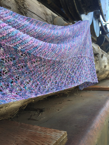 Joyous Mermaid Shawl hanging on a wooden wall