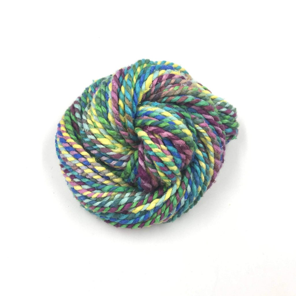 Ball of Darn Good Twist Yarn in Machu Picchu colorway on a white background