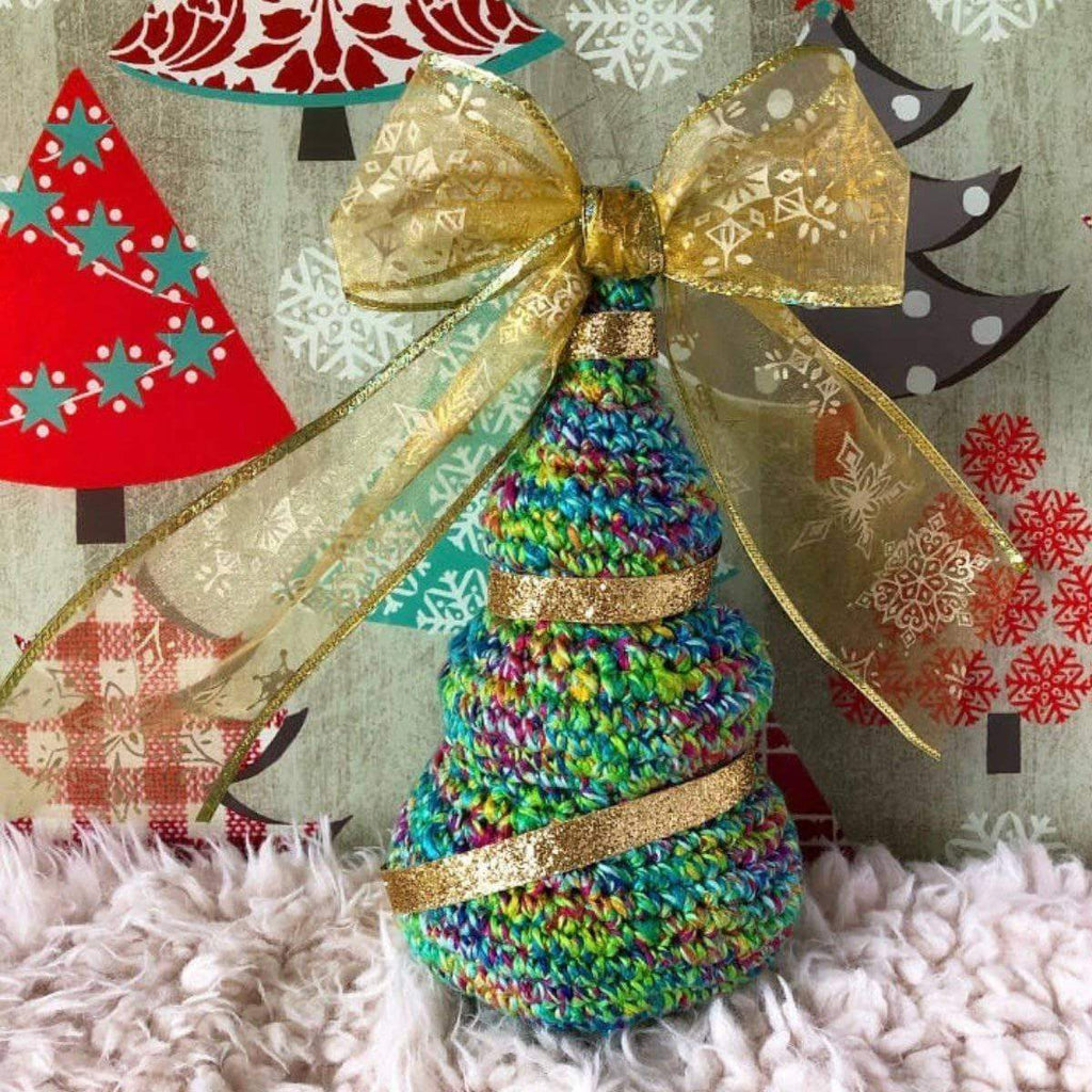 O'Whimsical Christmas Tree on a beige background with Christmas ribbons