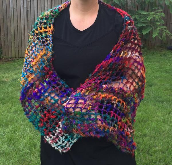 woman wearing a yarn shawl