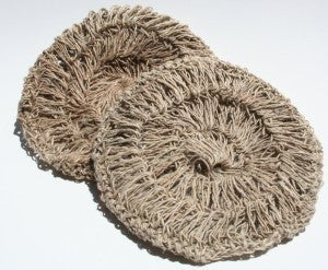 Two round flat hemp scrubbies on a white background