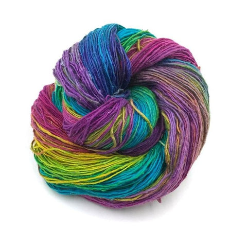 Silk Yarn ball in Watercolors colorway on a white surface