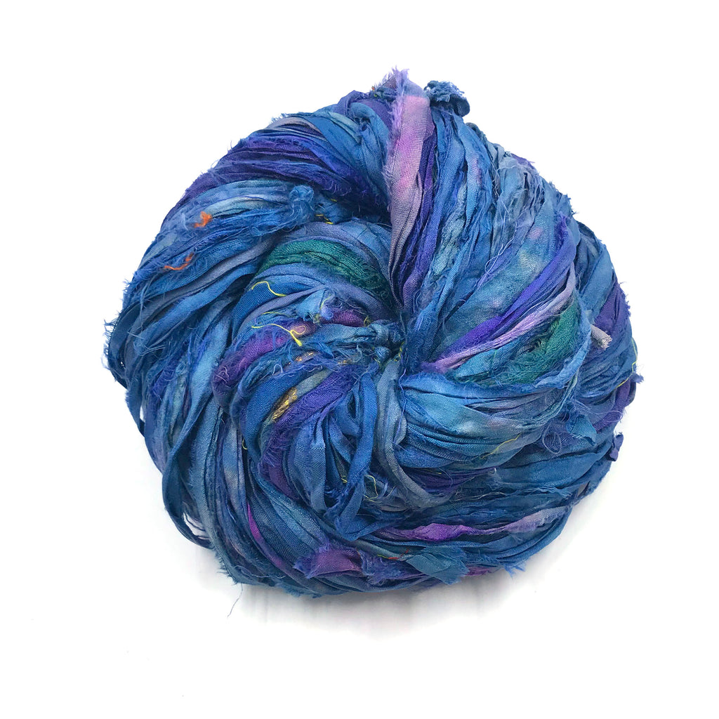Sari Silk Ribbon Yarn ball in Blue on a white background