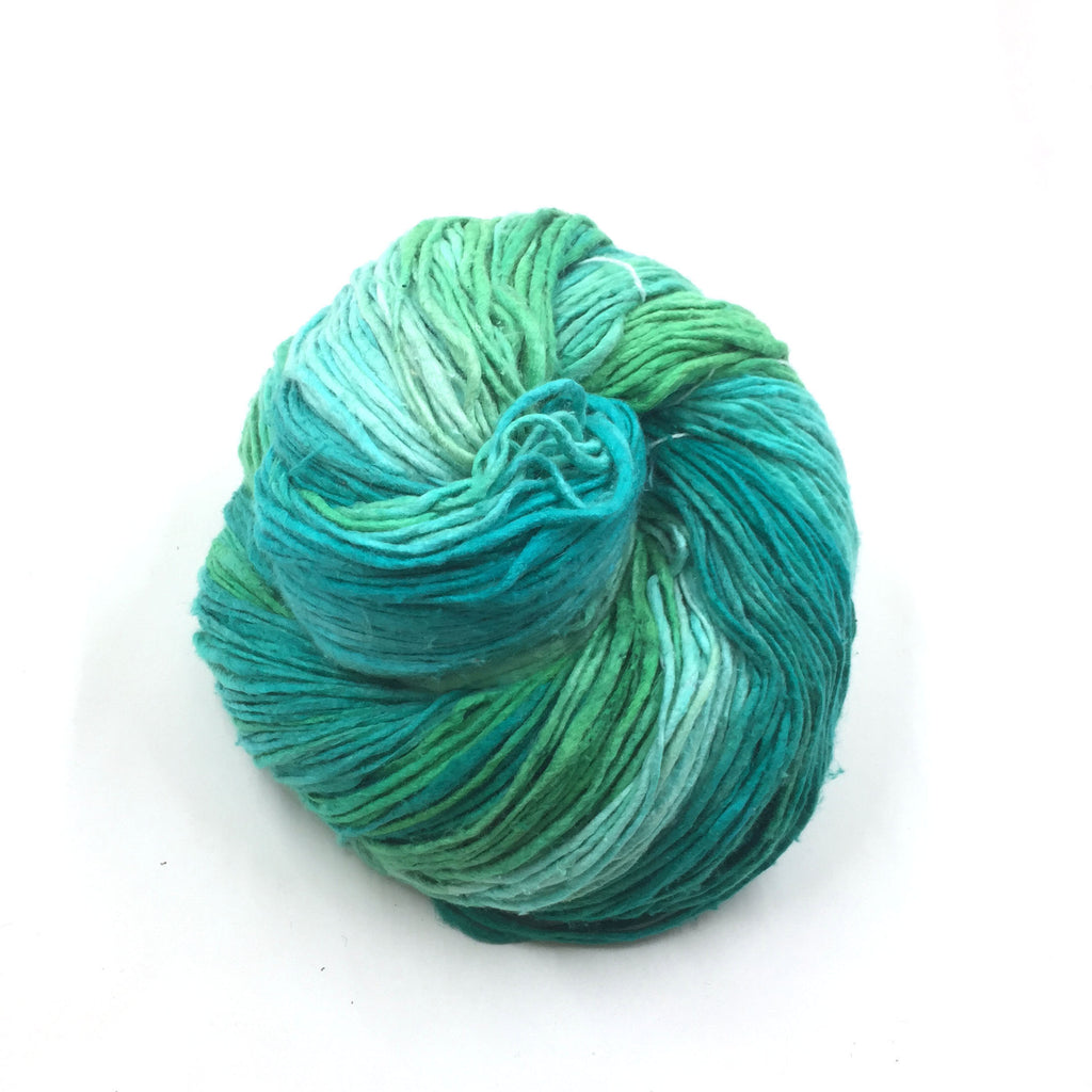 Ball of turquoise Worsted Weight Recycled Silk yarn on a white background