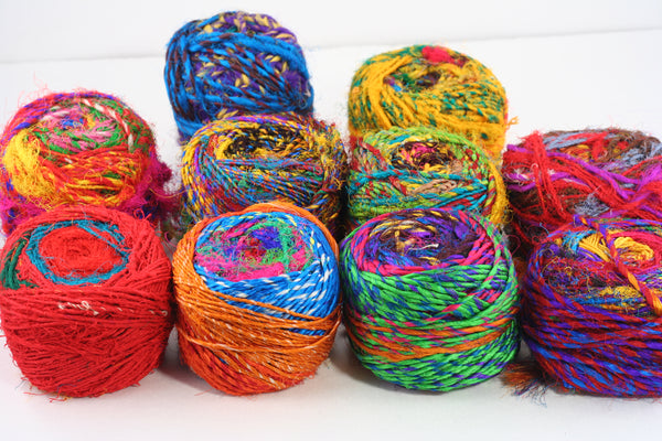 10 Spice Market Cakes of Yarn on a white background
