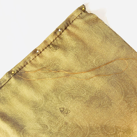 Close-up photo of pinned and sewn sari fabric.