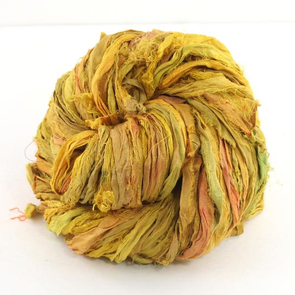 Yellow ball of silk ribbon yarn sitting on a white background