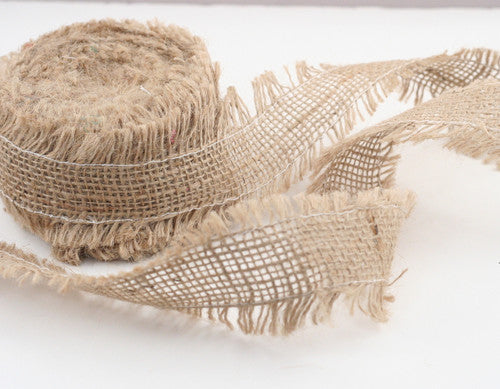burlap ribbon yarn over a white background